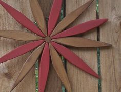 Looking for a unique outdoor decoration or gift? This beautiful Starburst is great for adding color to an outdoor wall or lightening up a garden area or fence. Many people like to place their starburst art indoors as well.  The warm red and cedar tones shown in the photos (Laughing Creek colors: Red Red and Natural Cedar) and friendly design is a subtle and refreshing welcome to guests at your front door. If you would like a different color assortment chosen from my Laughing Creek color…