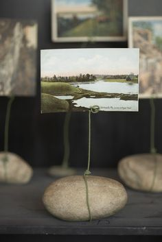 take a rock from a place you visit. add wire and a picture of that place. simple and beautiful.