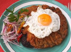 Lomo a lo pobre (Peruvian Breaded Steak, On Top Of Black Bean & Rice Patty, & Egg Over-Easy) Peruvian Dishes, Peruvian Cuisine, Peruvian Recipes, Peruvian Restaurant, Chefs, Breaded Steak, Comida Latina, Steak Bites, Latin Food