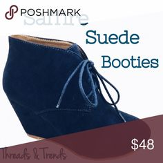 LAST PAIR! Saffire Suede Lace Up Booties Right on trend this season lace up faux suede wedge booties. In a gorgeous saffire blue. Be in style this fall/winter with a fabulous pop of color to demin, leggings, skinny pants, skirts or dresses. Threads & Trends Shoes Ankle Boots & Booties