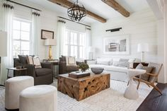 Marie Flanigan Interiors - Small Space Solutions - Benjamin Moore Cloud White - Teak Coffee Table - Stark Carpet - Hide Ottomans