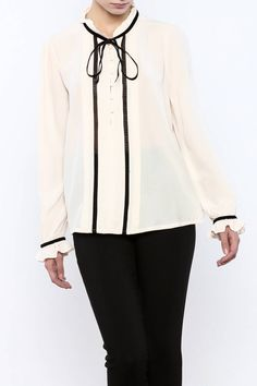 High neck velvet tie up detail button up blouse with ruffles at neck and wrist.   Tori Tie Blouse by Lucy Paris. Clothing - Tops - Long Sleeve Clothing - Tops - Blouses & Shirts Louisiana
