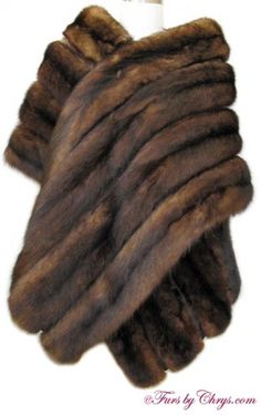 "SOLD! Long Sable Stole SS735;Excellent Condition; One Size Fits Most. This is a luxurious genuine sable fur stole in a rare long length. It is constructed of four rows of sable pelts with dark brown grosgrain between each row and 3"" of glorious sable fur also runs along the top inside hem. It has a Furs by Mann label. The sable fur is a rich dark brown, and it is silky soft and very lightweight. This is a very elegant sable stole that will be a lovely enhancement to your formal wardrobe!"
