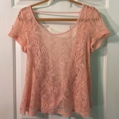 Drape back tee Baby pink drape back tee. Bought a while ago, I didn't ever wear it. This would be super cute with jeans or shorts. The front is lace and the back is open. Offers are welcome! Boutique Tops Blouses