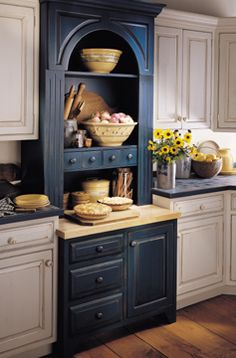 Baking center.  This is what I want to do between the cabinets.  Not the top part and in a wine color instead of blue