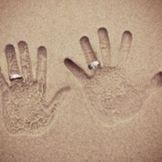 Wedding rings in sand pic
