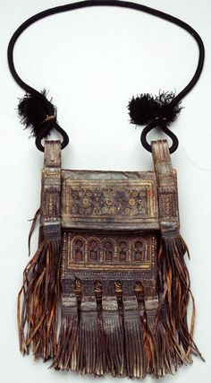 Moroccan shoulder bag | Royal Museum for Central Africa | I don't know where this can be bought, but it is our mission to find one like it!