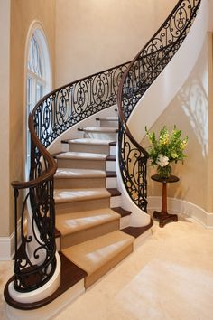 The Architecture Designs presents 22 beautiful traditional staircase design ideas to turn your traditional staircases into a unique one. Explore all ideas here. Wrought Iron Staircase, Winding Staircase, Iron Stair Railing, Staircase Railings, Curved Staircase, Modern Staircase, Grand Staircase, Stairways, Craftsman Staircase