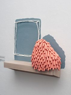 """Linda Lopez I'm not so weird to me 2011 Ceramic, wood, balloons, sand, foam, latex paint 55"""" x 6"""" x 21"""""""