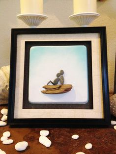 """Pebble Art """" Bump II """" Beach Decor Stone Rock People Baby Shower Gift. Baby Bump II . Pebble art of beach stones and driftwood gathered form the Pacific Coast of Washington State. 11 1/2 X 11 1/2 By 1 3/4 inches outside dimensions Unique Pedestal mounting frame . Ships same or next day VIA USPS Priority Mail 1 to 3 days delivery in the USA."""
