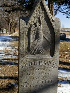 Angel pointing to city above, presumably Heaven.  Peter Robb.  Evergreen Cemetery in Beatrice, Nebraska.  Celestial Reflections Photography.
