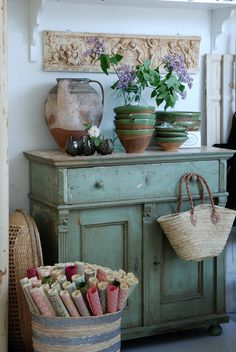 A piece like this celadon green chest anchors the room.