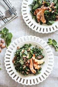 This collard green salad recipe is given a Vietnamese twist with loads of lime juice, fish sauce, fresh mint, toasted almonds and grilled shrimp - a complete healthy meal, and perfect for summer | www.feedmephoebe.com