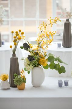 yellow and grey centerpiece @Jodi Hurley, you should totally do gray/yellow/green....instead of just green/yellow. You should totally just fly me home and let me become your wedding planner...