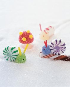 "Kids will have fun making these easy, adorable candy snails and mushrooms. Use them to decorate the yard of a gingerbread house or set up a miniature winter scene on a plate covered in sugar ""snow."""