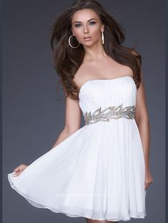 Goddess poly chiffon La Femme cocktail dress 16824. Be a woman of extraordinary beauty and charm wearing a dress Grecian inspired. A strapless gorgeous design features a slight sweetheart shaped neckline accented at the waist by a hand painted band that resembles a branch. A flowy skirt cascades above the knee length softly ruffling at the hem. Chandelier earrings and high heeled sandals will seal up this goddess look. Available in Black/Gold and White/Gold.
