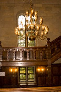 a chandelier and fancy woodwork highlight this section of the mansion at ridley creek state park