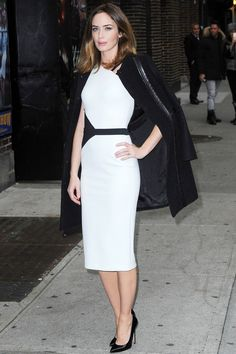 Emily Blunt opted for a David Koma monochrome dress with a Tory Burch coat and Brian Atwood heels.