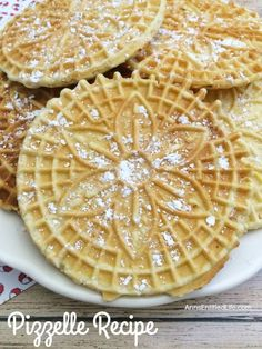 Pizzelles are a delicious Italian wafer cookie that my grandmother made every year for Christmas! Light and crispy these buttery vanilla pizzelles are great for the holidays dessert or anytime. Your family will gobble these right up.