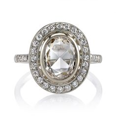 1.07ct KL/VS Rose cut diamond set in a handcrafted 18k natural white gold mounting. A halo design featuring a bezel set diamond, low profile, and intricate gallery.