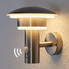 LED stainless steel outdoor wall light Lillie in a modern Northern style with integrated motion detector Stainless steel is the best when it. Led Exterior Wall Lights, Led Wall Lights, Solar Lights, Outdoor Sconce Lighting, Lighting Ideas, Motion Detector, Modern Wall Sconces, Lampe Led, Tinkerbell