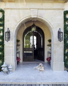 Waiting for his master at the front door of this Tuscan-style home in Santa Barbara...oh you lucky dog!