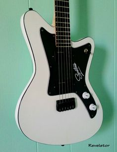 Olympic White Revelator SuperTone offset guitar with Black binding [It's stuff like this that makes me materialistic. I mean THIS is what money is for (and Trendlaser records, of course)-Trend]