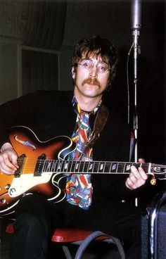 John Lennon playing an epiphone casino