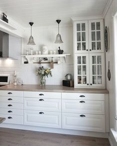 Stacked cabinets on countertop - plus glass doors