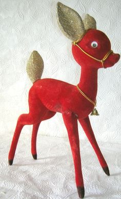 """Reindeer measures 12"""" Tall. He has glitter ears & googly eyes. Harness and Bell around his neck. 