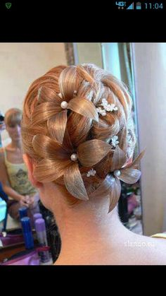Unique updo beautiful flowered hair