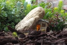 Lighted fairy/gnome house made to look as though it was built in to the side of a mountain. $14.95 plus shipping.