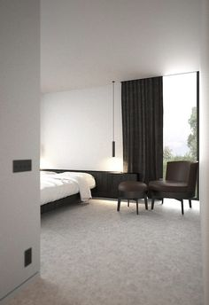 Calm bedroom by Belgian interior architects AD Office.