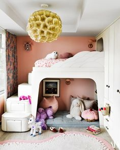 The daughter's bedroom, a pendant by Christy Manguerra hangs above a custom bed by Jamie Bush.