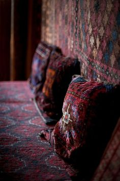 Layering rugs and pillows.