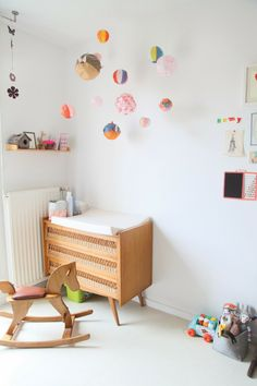 Minimalistic nursery with a mid-century modern vibe.