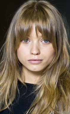 CUT | BANGS - Long rounded bangs; shorter in middle and curve down toward the temple