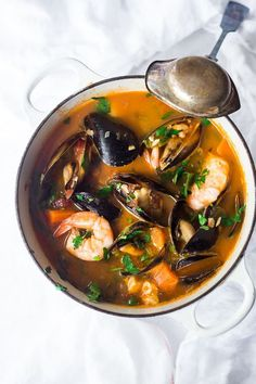 Simple Authentic Cioppino that is easy to make and full of flavor. Fresh fish and seafood in a flavorful light broth. Serve with crusty bread to mop up all the juices. #cioppino #seafoodstew #fishermansstew #italianstew #cioppinorecipe