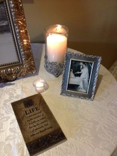 Picture of bride's parents at their wedding on the welcome table.