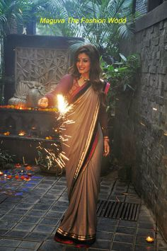 Raveena Tondon celebrated Diwali wearing Shimmer grey color saree with voilet-pink patch teamed up with full sleeve purple blouse