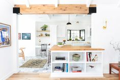 Kitchen! GET IN MY MOUTH! This kitchen by Homepolish LA's Stefani Stein wins an A+ from me for being both bright and unabashedly homey. I love the wooden beams on the ceiling and the gorgeous built-in shelving that showcases the homeowner's book/object collection.