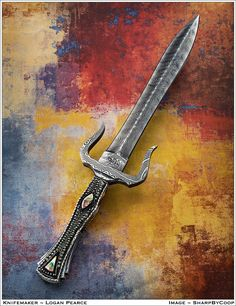 Preview of my #Maleficent dagger. Silver filigree and mother of pearl handle with damascus handle, guard, and blade! Logan Pearce Knives.