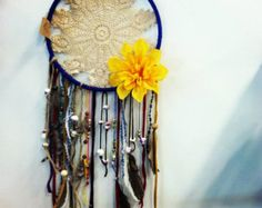 Gorgeous bohemian doily dream catchers. Available in multiple colors. Made with lace, beads, fabric and feathers.