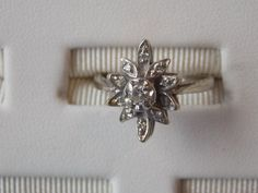 Not a big, flashy jewelry (especially diamonds) kinda gal usually, but this ring is super unique. 14kt Starburst White Gold Diamond 1/3ctw by BentleysJewelry, $400.00