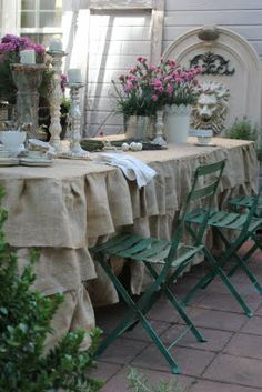 I'm liking this burlap tablecloth made with ruffles...although I would think it would be itchy to sit next too...maybe at the buffet table.
