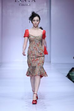 A model parades a creation by Chinese fashion house TANYA Haute Couture 2012/2013 collection during the bi-annual China Fashion Week in Beijing on March 31, 2012.