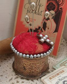 Pin cushion- use old napkin rings for the base.