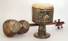 Persian Instruments, Long-necked lute (tār), Goblet drum (zarb or dombak), Iran (Persia), ca. 1925 on Exhibit at the National Music Museum