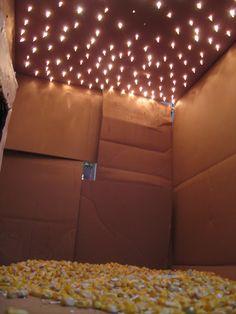 Christmas lights through a cardboard box!