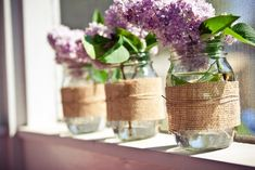 Wrap mason jars with burlap and raffia for super cute vases! Filled here with wild lilac.